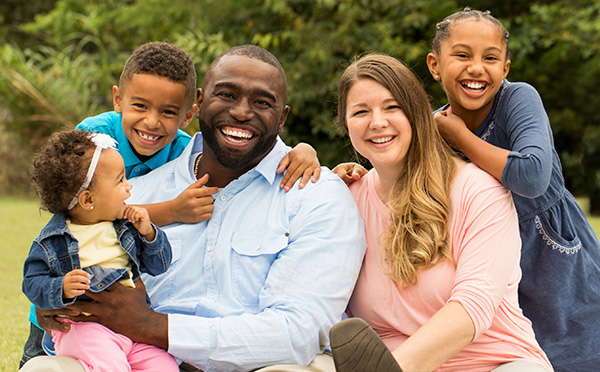 Young smiling family with kids